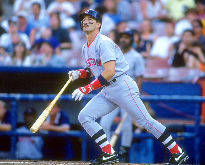 """Mike Greenwall follows the path of the ball during a game against Cleveland. """"The Gator"""" patrolled Fenway's Green Monster for 11 seasons and was MVP runner-up in 1988."""