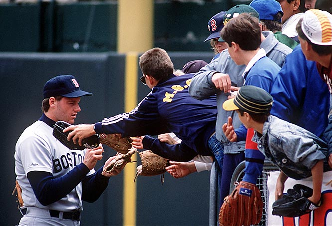 Roger Clemens signs autographs for fans in right field. Clemens spent 13 seasons in Boston and is tied with Cy Young for most wins in a Red Sox uniform (192).