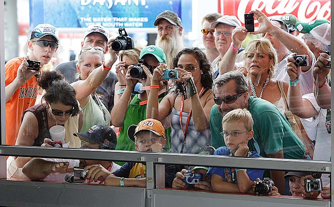 Is that Junior?  Fans gather to try to get a glimpse of the star at a practice run.