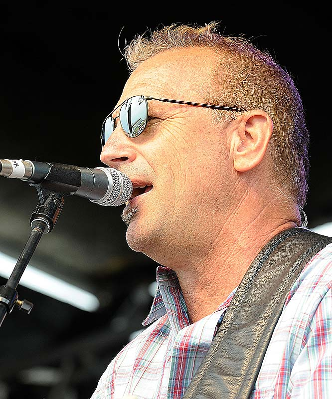 Kevin Costner performs with his band, Modern West, at the Sprint All-Star Race