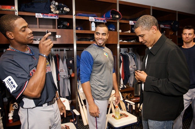 Tigers centerfielder Curtis Granderson snaps a keepsake while Nelson Cruz looks on.