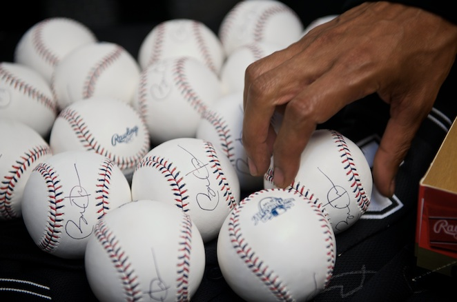 The umpires got to take home autographed baseballs from the president.