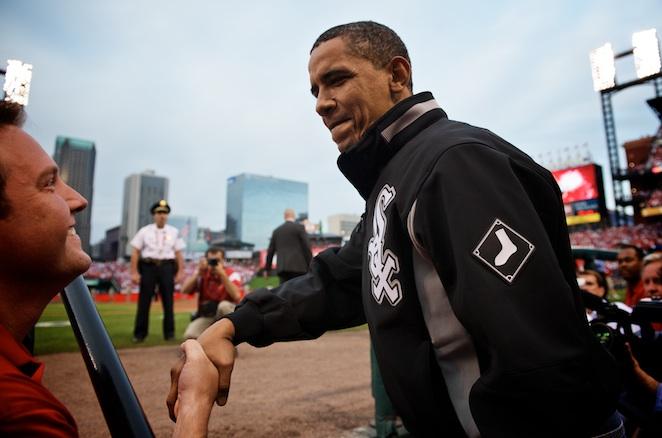 The Busch Stadium crowd welcomed President Obama as he emerged from the National League dugout.