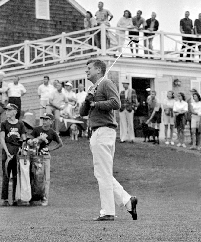 John F. Kennedy tees off at The Hyannis Port Country Club in Massachusetts.