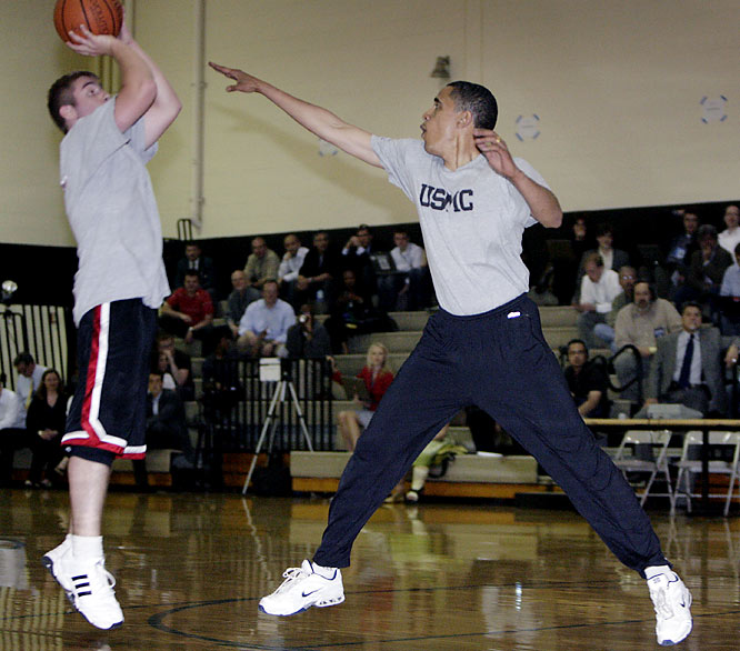 Barack Obama challenges an opponent's jump shot during a campaign stop at Maple Crest Elementary  in Kokomo, Ind.