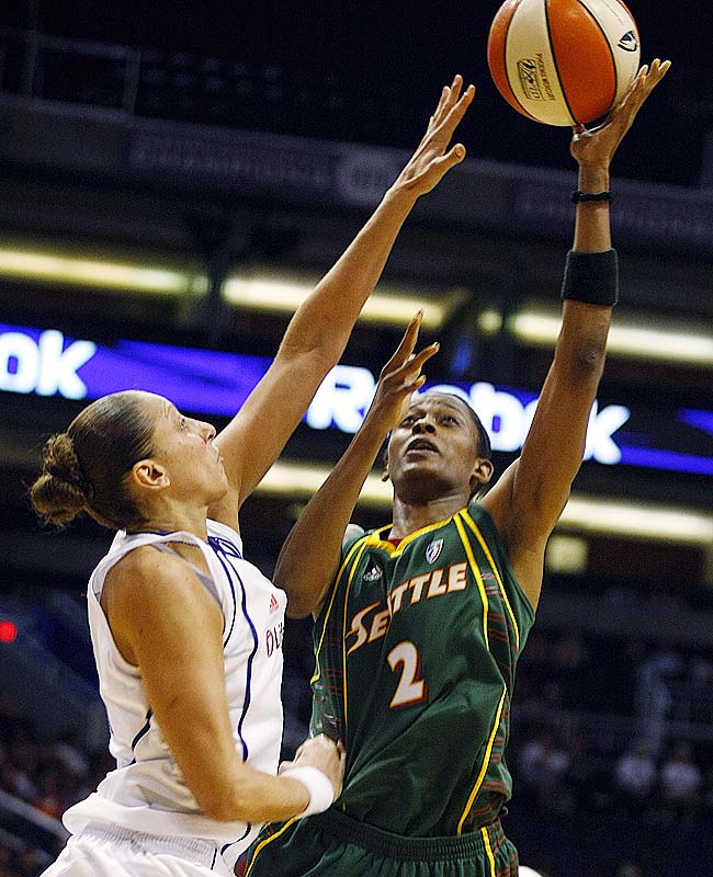 And speaking of former Huskies, what's gotten into Swin Cash (pictured)? The former All-America and second overall pick in 2002 seems like she's back to her old self after having surgery to repair a herniated disc during the offseason. On Tuesday she led Seattle with 18 points and 12 rebounds in a 66-53 over San Antonio. Her resurgence can only make life easier for Lauren Jackson, who continues to struggle as more teams dedicate more personnel to stopping her.
