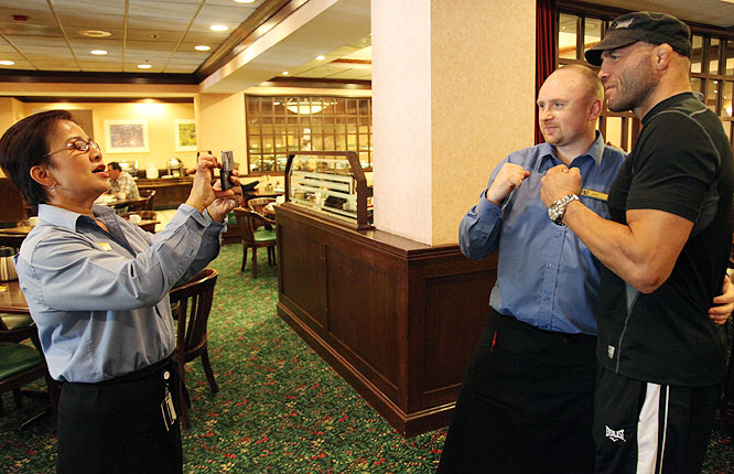 Randy Couture spent much of his day Friday signing autographs and posing for photos with fans in Portland.