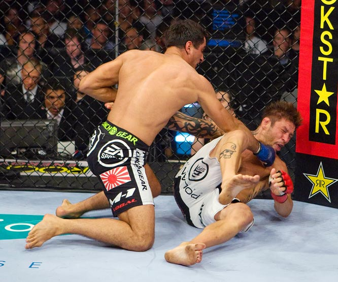 In his U.S. debut, Gegard Mousasi (black trunks) scored a TKO win over Babalu for the Strikeforce light heavyweight title.