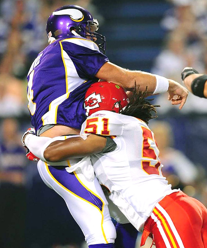 "It didn't take long for Brett Favre to get in ""tackling shape,"" as Chiefs linebacker Corey Mays bullrushes the future Hall of Famer to the turf."