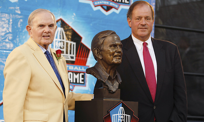 "ESPN personality Chris Berman (right) welcomed Wilson to the Hall of Fame, with a rousing, insightful ""circle the wagon"" speech before the Canton faithful."
