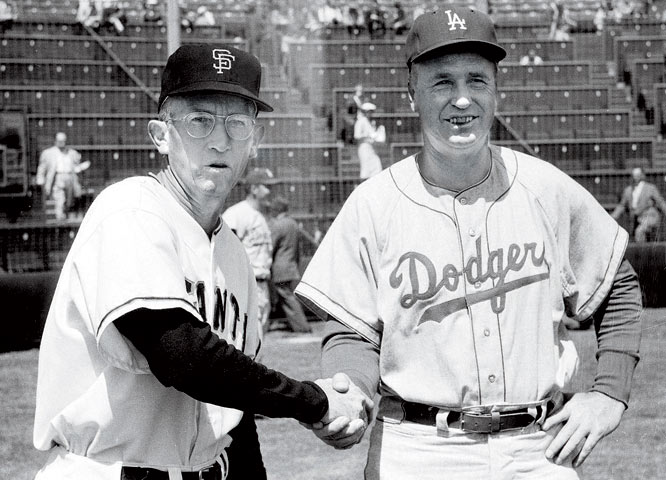 San Francisco Giants manager Bill Rigney shakes hands with Los Angeles Dodgers manager Walter Alston.