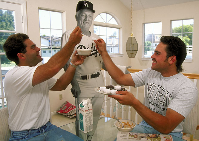 Roommates Eric Karros and Mike Piazza feed cereal and donuts to a cut-out of Dodgers manager Tommy Lasorda.
