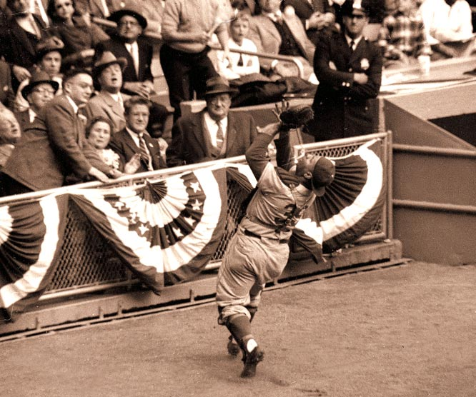 Roy Campanella makes a catch along third base during a World Series game against the Yankees.