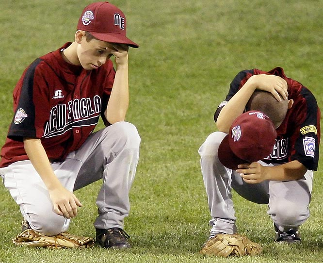 J.J. Layton (left) and Matt Correale of Peabody, Mass., ponder what went wrong as they await a pitching change amid a 12-run sixth inning. Peabody lost 14-0 to Chula Vista, Calif.