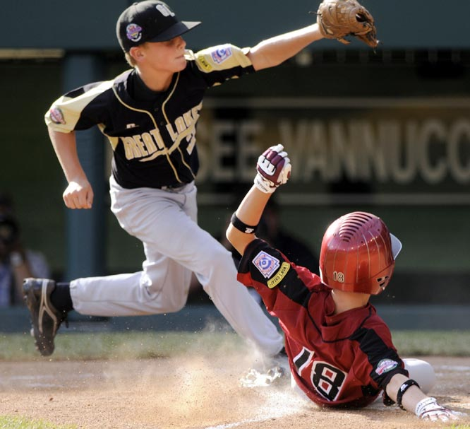 Peabody, Mass.'s Matt Gonick (right) scored on a wild pitch in 12-3 win over Russellville, Ky.