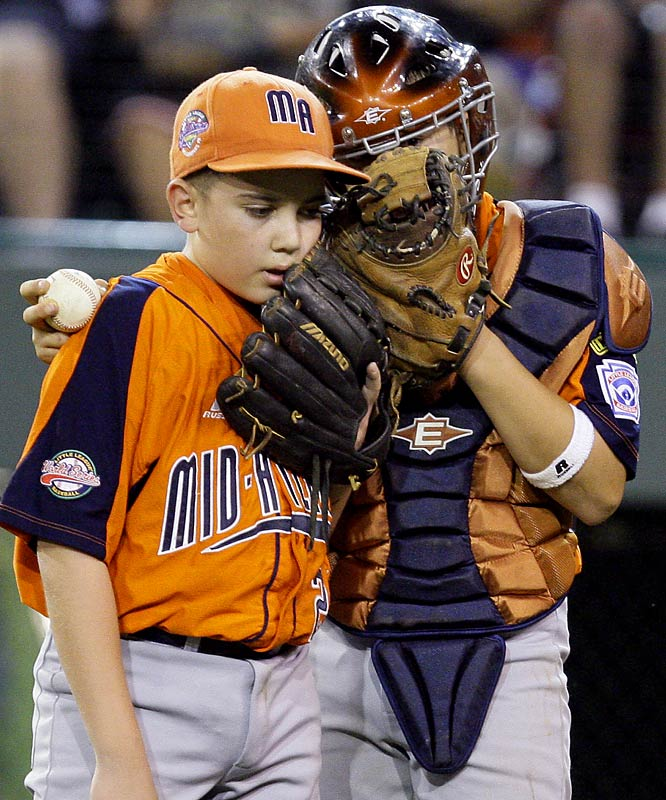 Staten Island pitcher Michael Rapaglia and catcher James Morisano discuss strategy during their victory over Iowa. Rapaglia struck out seven over four-plus innings to advance the New Yorkers to a Wednesday night semifinal against either Texas or California.