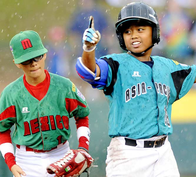 Taiwan's Chin Ou reacts to his RBI double in the sixth inning as Mexico's Agustin Montoya looks on. Taiwan advanced to the LLWS final with a 9-4 win.