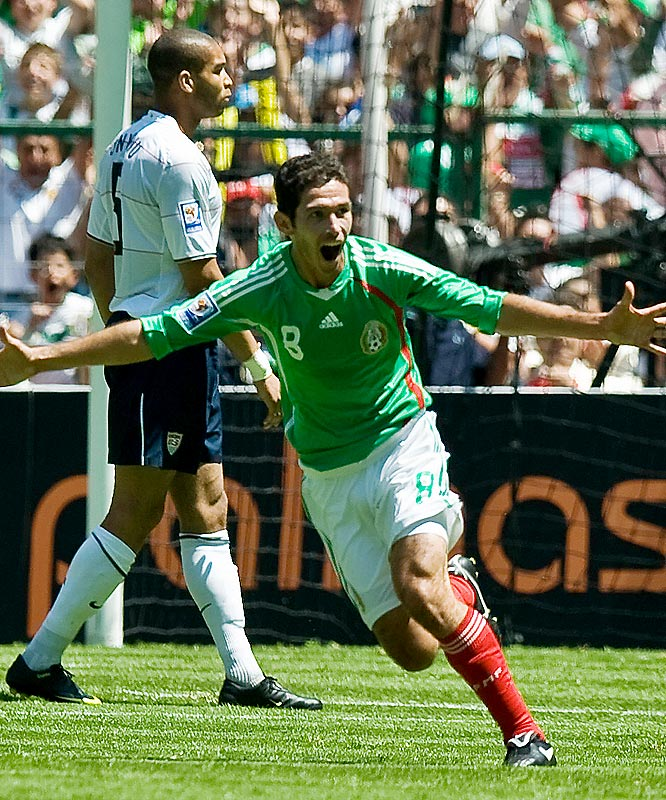 Israel Castro of Mexico celebrates his 82nd-minute goal as American Oguchi Onyewu looks on.