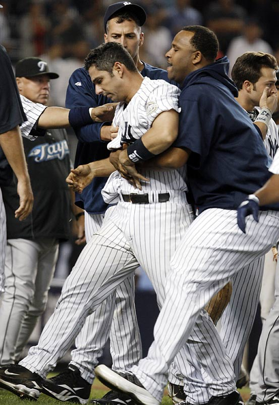 "After Yankee pitchers hit Edwin Encarnacion and Aaron Hill, Jesse Carlson threw behind Jorge Posada. Posada responded with some angry words and took a few steps toward the mound, causing both benches to clear, but order was quickly restored. A short time later, Posada elbowed Carlson after crossing home plate and the two players got into a tussle, leading to a bench-clearing brawl. ""It got pretty heavy and pretty thick pretty quickly,"" Alex Rodriguez said. ""I think we're all fortunate and glad no one got hurt."""