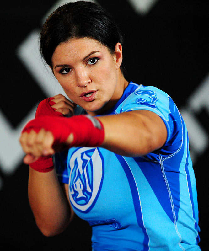 "Gina Carano puts her undefeated record on the line against Cristiane ""Cyborg"" Santos for the inaugural Strikeforce women's championship Saturday night, 10:30 p.m. on Showtime.  Carano, a former American Gladiators star, is the underdog, but after training with Randy Couture, it should be a great -- and definitely groundbreaking -- fight."