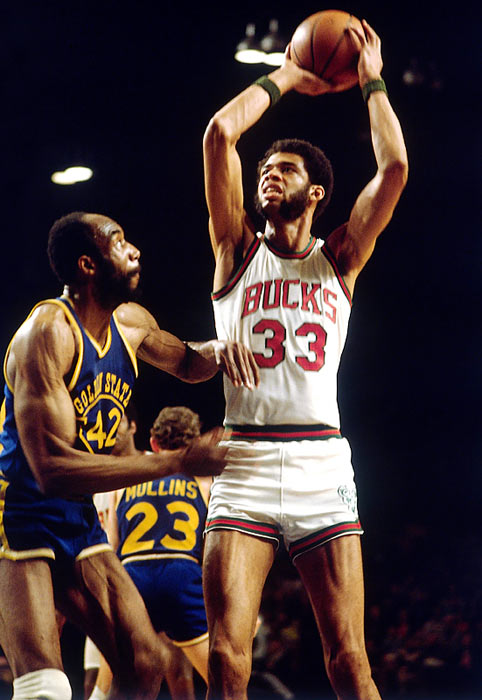 Though he won only a single title in the `70s, with the Bucks in '71, Abdul-Jabbar dominated the decade in every other way. Relying on his trademark sky hook, Abdul-Jabbar won back-to-back MVP awards twice in the `70s and had three consecutive seasons in which he averaged at least 30 points and 16 rebounds. He would add five more titles as a member of the Lakers in the `80s.