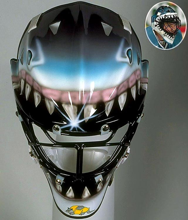 "While Hayward was in net for the Sharks when they won their first ever NHL regular season game, he is far better known for his mask (another Armadilla design by Straus), looking as though he is peering out from the jaws of a great white.  This mask began the trend of having a creature on the mask appearing to devour the person inside of it.  To quote Robert Shaw from  Jaws , ""This shark, swallow you whole."""