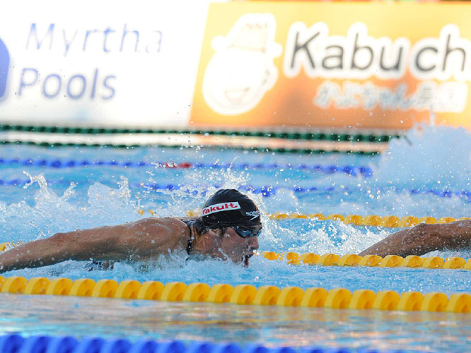 As expected, Phelps trailed after the first 50 meters, but began to close the gap.