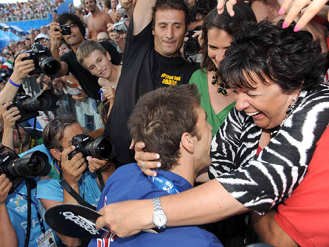 Photographers surrounded the Phelps family as Michael shared the moment with his mother Debbie.