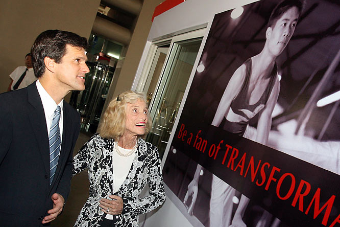 Chairman of the Special Olympics, Timothy P. Shriver, and his mother Eunice Kennedy Shriver, view a promotional poster before the opening ceremony of the Special Olympics World Summer Games in Shanghai, October 2, 2007.  A record 7,300 athletes from 164 countries and regions would compete in 21 medal sports and four demonstration competitions at the games.