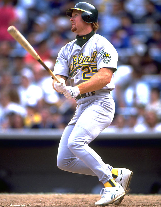 Mark McGwire set the record for home runs by a rookie when he connects on his 39th of the season.