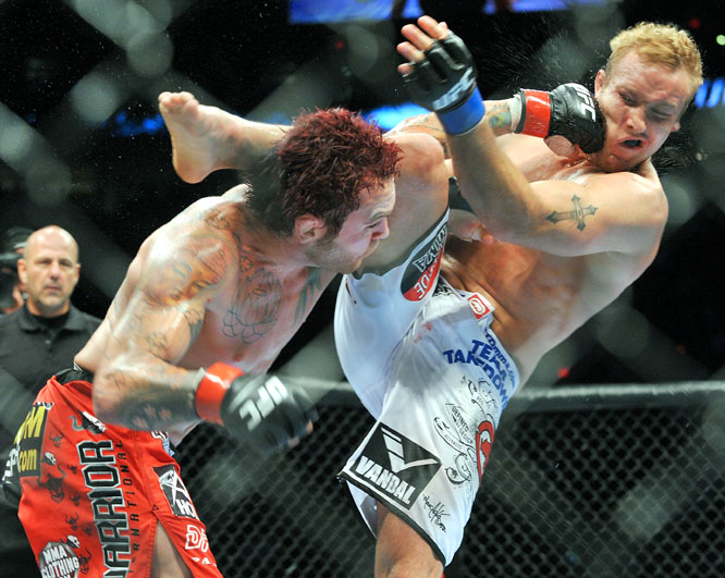 Hometown favorite Chris Leben (left) looked good here, but he was upset by four-time All-American wrestler Jake Rosholt at 1:20 of Round 3.