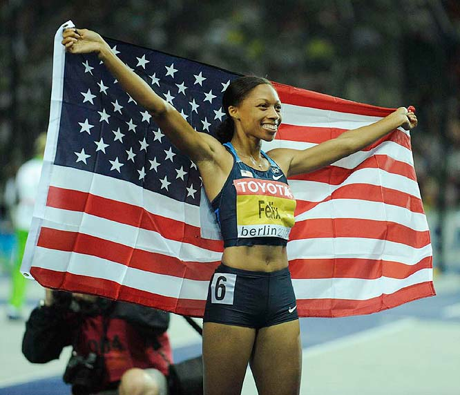 Allyson Felix took the gold in the 200 meters, topping rival Veronica Campbell and becoming the first three-time world champion in the event.