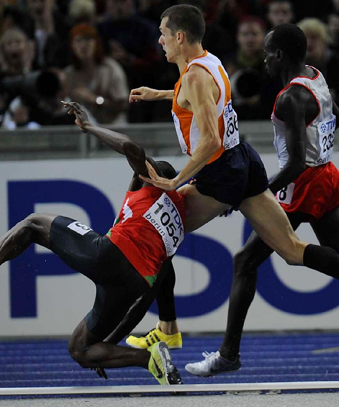 Abubaker Kaki of Sudan, a title favorite in the 800 meters, knocks over Bram Son, of the Netherlands, during the first semifinal.