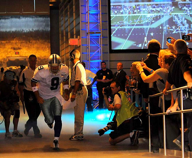 To get to the field, Romo and his teammates run past adoring fans.