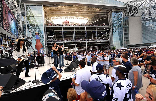 Pregame rock 'n roll entertained the fans as they entered the new stadium.