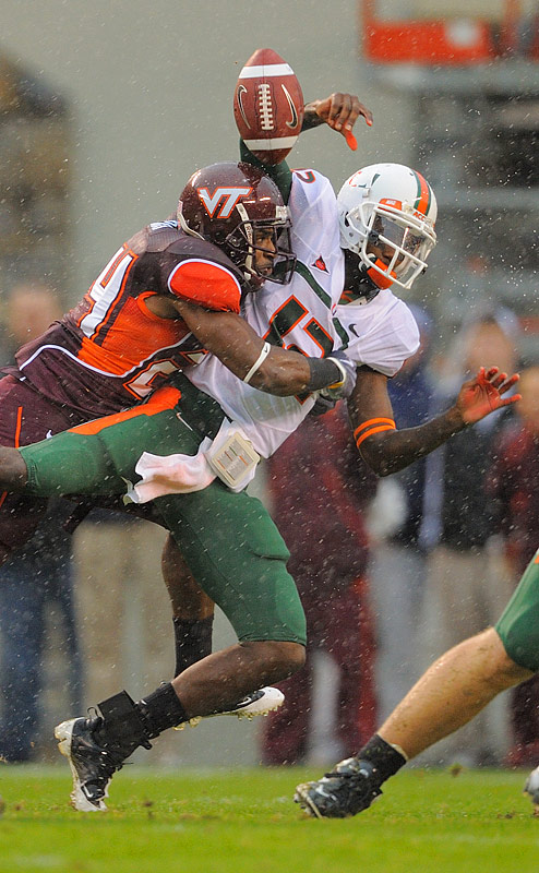 Cornerback Dorian Porch forces Miami quarterback Jacory Harris to fumble during the Hokies win.