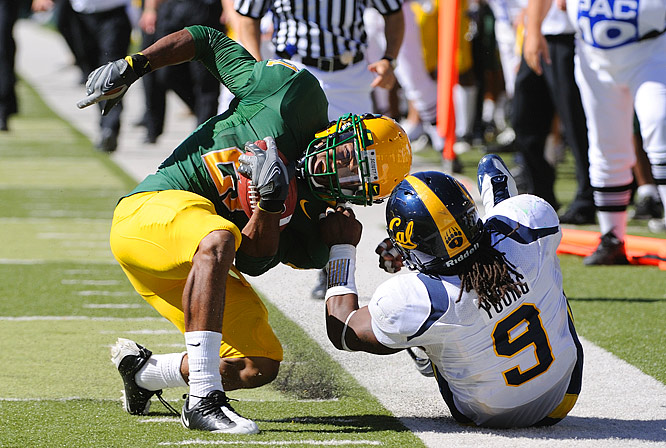 Cal linebacker Eddie Young pulls down Oregon running back LaMichael James.