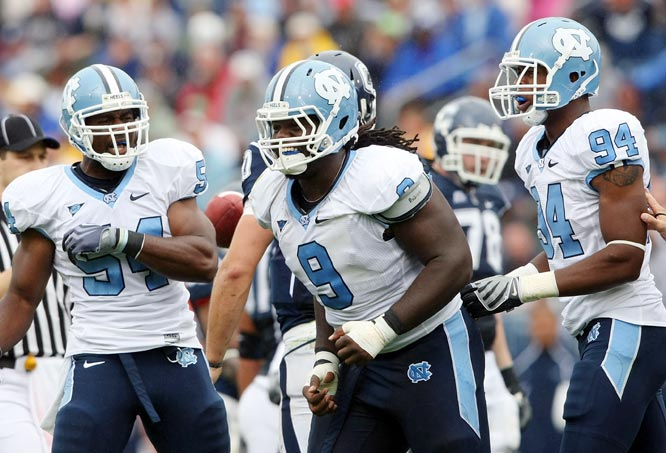 Connecticut's Dan Ryan was called for holding in the end zone, giving Bruce Carter (54), Marvin Austin (9), Michael McAdoo and the Tar Heels the win in East Hartford.