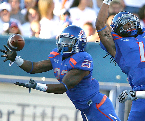 The offense may get all the publicity, but the defense (including Jeron Johnson, right) is driving this year's Broncos, who yielded only 14 first downs and 194 yards on Saturday.