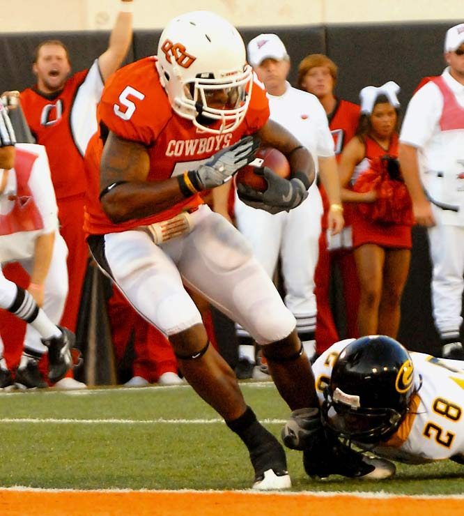 Keith Toston ran for 84 yards and three first-half touchdowns, and Oklahoma State overpowered Grambling State even without its star running back Kendall Hunter and wide receiver Dez Bryant.