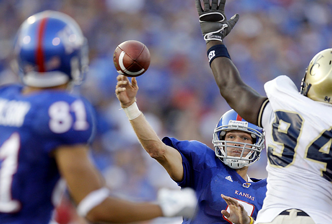 Kansas' Todd Reesing (center) did it through the air (208 yards, two scores) as well as on the ground (79 yards, two scores) to lead the Jayhawks to 547 yards of total offense.