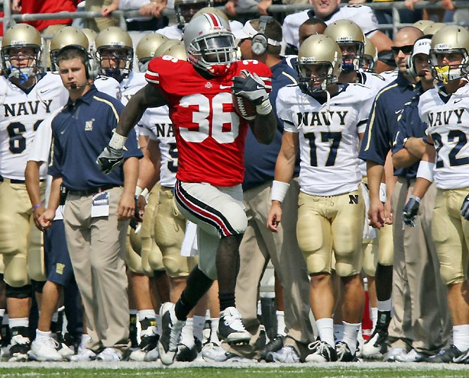 Brian Rolle intercepted a potential two-point conversion in the closing minutes as the Buckeyes avoided the upset against the Midshipmen. It was Ohio State's 31st straight season-opening win.