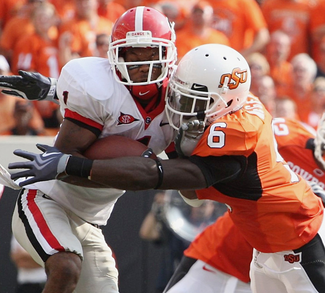 Oklahoma State's Andrew McGee (right) displays his defensive intensity while stopping Georgia's Branden Smith. The Cowboys limited the Bulldogs to 4-of-12 on third-down situations.