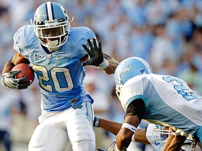 Shaun Draughn (left) sidesteps a would-be tackler en route to piling up 116 rushing yards on 20 carries. The Tar Heels collected 261 yards on the ground.