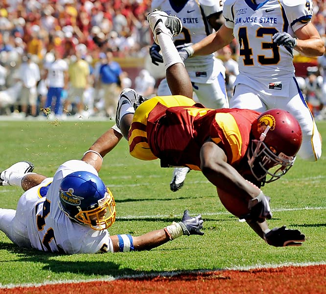 USC's Joe McKnight (right) tumbles into the end zone to cap a second-quarter drive. After trailing 3-0 after the first quarter, the Trojans scored the final 56 points. McKnight finished with 145 yards and two touchdowns on 14 carries.