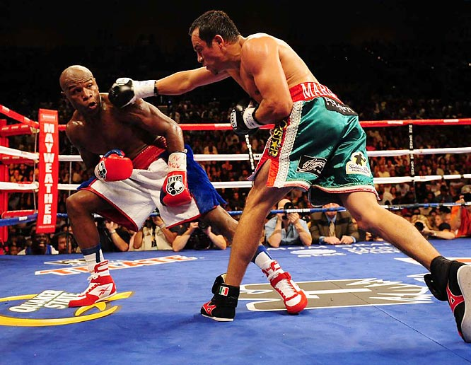 "Said Mayweather: ""I've been off for two years, so I felt like it took me a couple of rounds to really know I was back in the ring again."""