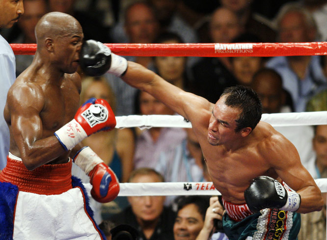 """When I hit him, he laughed, but I knew he felt my punches,"" Marquez said. ""We tried to work the speed, but the difference was the weight."""