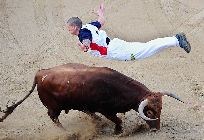 A 'recortador' jumps over a bull during a bull leaping contest show at the Plaza Monumental bullring in Barcelona, Spain, Friday Sept. 25, 2009.