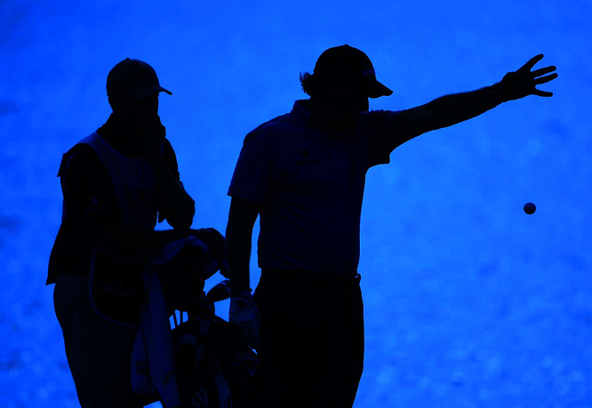 Phil Mickelson and caddie Jim Mackay on 17th fairway during the final round of The Tour Championship golf tournament at East Lake Golf Club in Atlanta Sunday, Sept. 27, 2009.