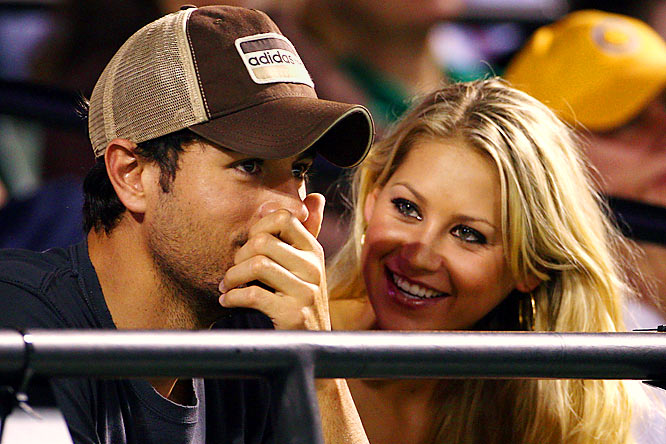 Rumors are circulating that Kournikova and Iglesias might be engaged after they were spotted shopping for rings at the Cartier Champs-Elysees boutique in Paris. Have they really been dating for eight years now? They should get some kind of an award for that considering they'll never win one for their singing or tennis ability.